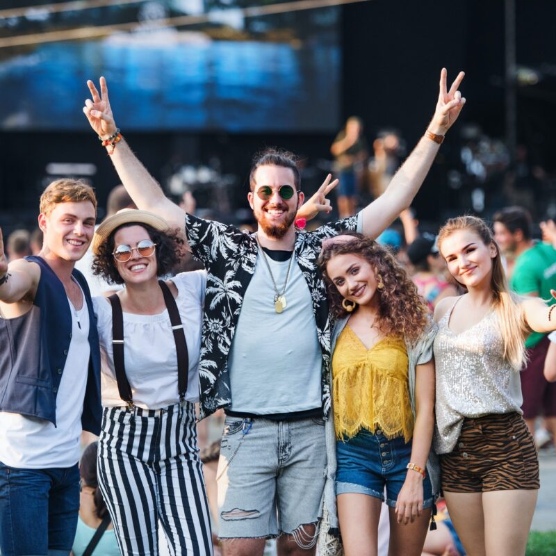 Group of young friends at summer festival.